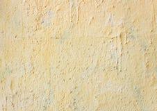 Jasnożółty szorstki sztukateryjny tło Zdjęcie Stock