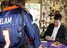 Jason Elam Autographs Novels for Fans Stock Photos