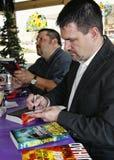 Jason Elam en autograph van Steve Yohn Hun Romans Royalty-vrije Stock Foto