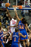 Jason Maxiell Dunks On Renaldo Balkman Royalty Free Stock Photos
