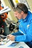 Jason Plato. THRUXTON, UNITED KINGDOM - MAY 1, 2011: Jason Plato, reigning British Touring Car champion driver signing autographs before racing at the Thruxton Royalty Free Stock Photos