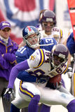 Jason Sehorn tackles Randy Moss. New York Giants DB Jason Sehorn, #31 tackles Minnesota Vikings WR Randy Moss Royalty Free Stock Photos