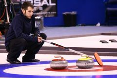 Jason Smith - USA Olympic Curling Team Athlete. Jason Smith directs his teammates  during the Men's US Curling Olympic Trials Finals at the Broomfield Event Stock Image
