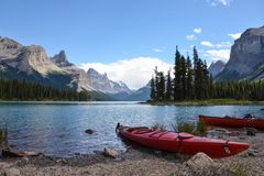 Maligne Canyon kayaks. JASPER, AB / CANADA - JULY 23, 2017:  Kayaks rest near an islet in Maligne Lake in Jasper National Park Royalty Free Stock Photo