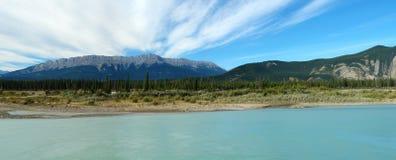 Jasper lake and rocky mountains Stock Photos