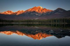 Lake reflection with mountain background stock image