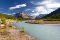 Jasper National Park, Alberta, Canada. Beautiful canadian landscape with river, mountains and cloudy sky taken on sunny day of autumn in Jasper National Park Royalty Free Stock Photography