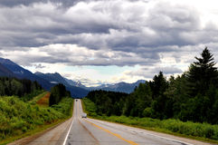 Jasper National park landscape in Canada Rocky Mou. A view of Jasper national park wilderness along the road with trees, mountains and a dramatic sky Stock Image