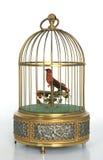 Jaula de pájaro musical de oro con el pájaro rojo Imágenes de archivo libres de regalías