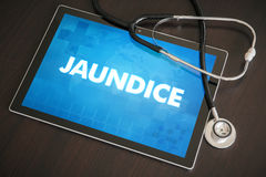 Jaundice (liver disease) diagnosis medical concept on tablet. Screen with stethoscope Royalty Free Stock Images