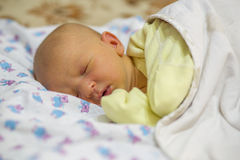 Jaundice in a newborn baby. A newborn child is ill with jaundice Royalty Free Stock Photo