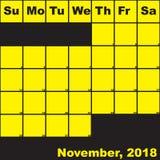 Jaune de 2018 novembre sur le calendrier noir de planificateur Photos libres de droits