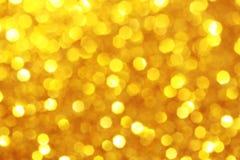Jaune, fond d'étincelle d'or Photos libres de droits