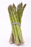 Jaunty Asparagus. Asparagus spears with purple rubber bands keeping them together at a jaunty angle isolated against white Stock Photography