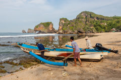 JAVA, INDONESIA - Apr 10, 2015: Fishermen taking. royalty free stock photo