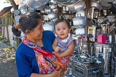 JAVA, INDONESIA - DECEMBER 21, 2016: Mother and child doing shop Stock Photography