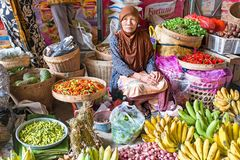 JAVA, INDONESIA - December 18, 2016: Sales woman on the market s. Elling vegetables on 18th of december 2016 on Java Indonesia Stock Image