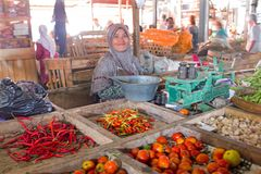 JAVA, INDONESIA - DECEMBER 18, 2016: Sales woman selling vegetab. Les on the market on Java Indonesia 18th december 2016 Royalty Free Stock Images