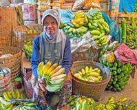 JAVA, INDONESIA - DECEMBER 18, 2016: Sales woman selling vegetab Stock Image