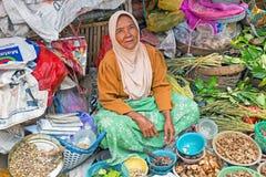 JAVA, INDONESIA - DECEMBER 18, 2016: Sales woman selling vegetab. Les on the market on Java Indonesia 18th december 2016 Stock Image
