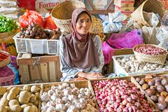 Sales woman selling vegetables on the market on Java Indonesia Royalty Free Stock Photography