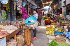 JAVA, INDONESIA - December 18, 2016: Sales women on the market s. Elling vegetables on 18th of december 2016 on Java Indonesia Royalty Free Stock Photo