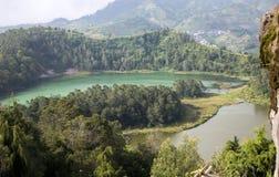 Java, Indonesia. Telaga Warna-color volcanic lakes on the plateau Diyeng stock images