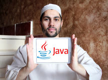 Java logo. Logo of java on samsung tablet holded by arab muslim man. Java is a general-purpose computer programming language Royalty Free Stock Photos