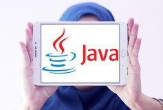 Java logo. Logo of java on samsung tablet holded by arab muslim woman. Java is a general-purpose computer programming language Royalty Free Stock Image