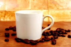 Java Time. Photo of Coffee Beans and a Coffee Cup royalty free stock photo