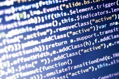 Javascript code. Computer programming source code. Abstract screen of web developer with glowing code. Royalty Free Stock Images