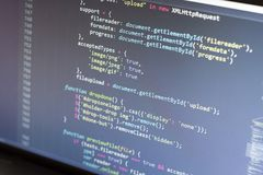 Javascript code. Computer programming source code. Abstract screen of web developer. Digital technology modern background. Shallow Royalty Free Stock Image