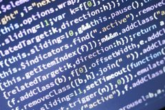 Javascript code. Computer programming source code. Abstract screen of web developer with glowing code. Royalty Free Stock Photography