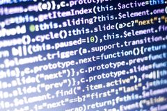 Javascript code. Computer programming source code. Abstract screen of web developer with glowing code. Royalty Free Stock Photo
