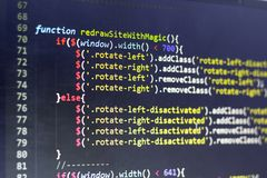 Javascript front-end code. Computer programming source code. Abstract screen of web developer. Digital technology modern background in warm colors. Shallow Royalty Free Stock Photo