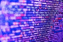 Javascript functions, variables, objects. Closeup of Web Code on Computer LED Screen. Programmer working on computer screen.