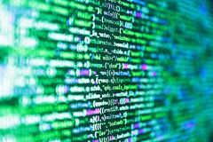 Javascript functions, variables, objects. Programmer working on computer screen. Programming code abstract background screen of