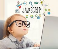 JavaScript text with toddler girl. Using her laptop Royalty Free Stock Photo