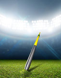 Javelin In Generic Floodlit Stadium Royalty Free Stock Photography