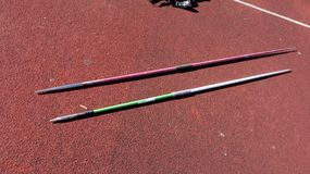 Javelin throw practise. In summer royalty free stock photo
