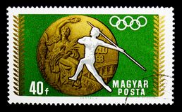 Javelin Throw, Summer Olympic Games 1968, Mexico City (2) serie,. MOSCOW, RUSSIA - MARCH 18, 2018: A stamp printed in Hungary shows Javelin Throw, Summer Olympic royalty free stock photo