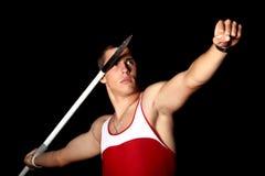 Javelin thrower. Athlete throwing javelin studio shot Royalty Free Stock Image