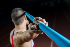 Javelin Thrower. Young Attractive Athlete Throwing Javelin Studio Shot Royalty Free Stock Images