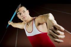 Javelin Thrower. Young Attractive Athlete Throwing Javelin Studio Shot Royalty Free Stock Image