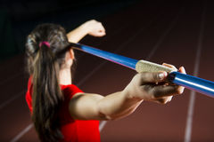 Javelin Thrower. Young attractive athlete throwing javelin studio shot Stock Image
