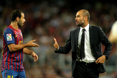 Javier Mascherano and Pep Guardiola. Guardiola trainer of FC Barcelona gives orders to Javier Mascherano during the spanish league match against Osasuna at the royalty free stock photos