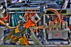 Jaws of life. The high powered cutting machinery used to cut through car body metal at an automobile accident. The machinery is attached to the side of a fire royalty free stock photography