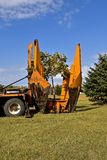 Jaws for transplanting a tree. The jaws of a mounted machine for transplanting a machine are being lifted after a successful sapling transplant Stock Images