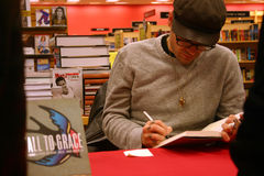 Jay Bakker signs copies of 'Fall to Grace'. ATLANTA, GA - JAN. 19: Jay Bakker reads from his book, signs copies and takes questions at an event on the book tour Stock Photos