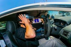 Jay Kay of Jamiroquai driving an Aston Martin on Kyalami Race Track stock images